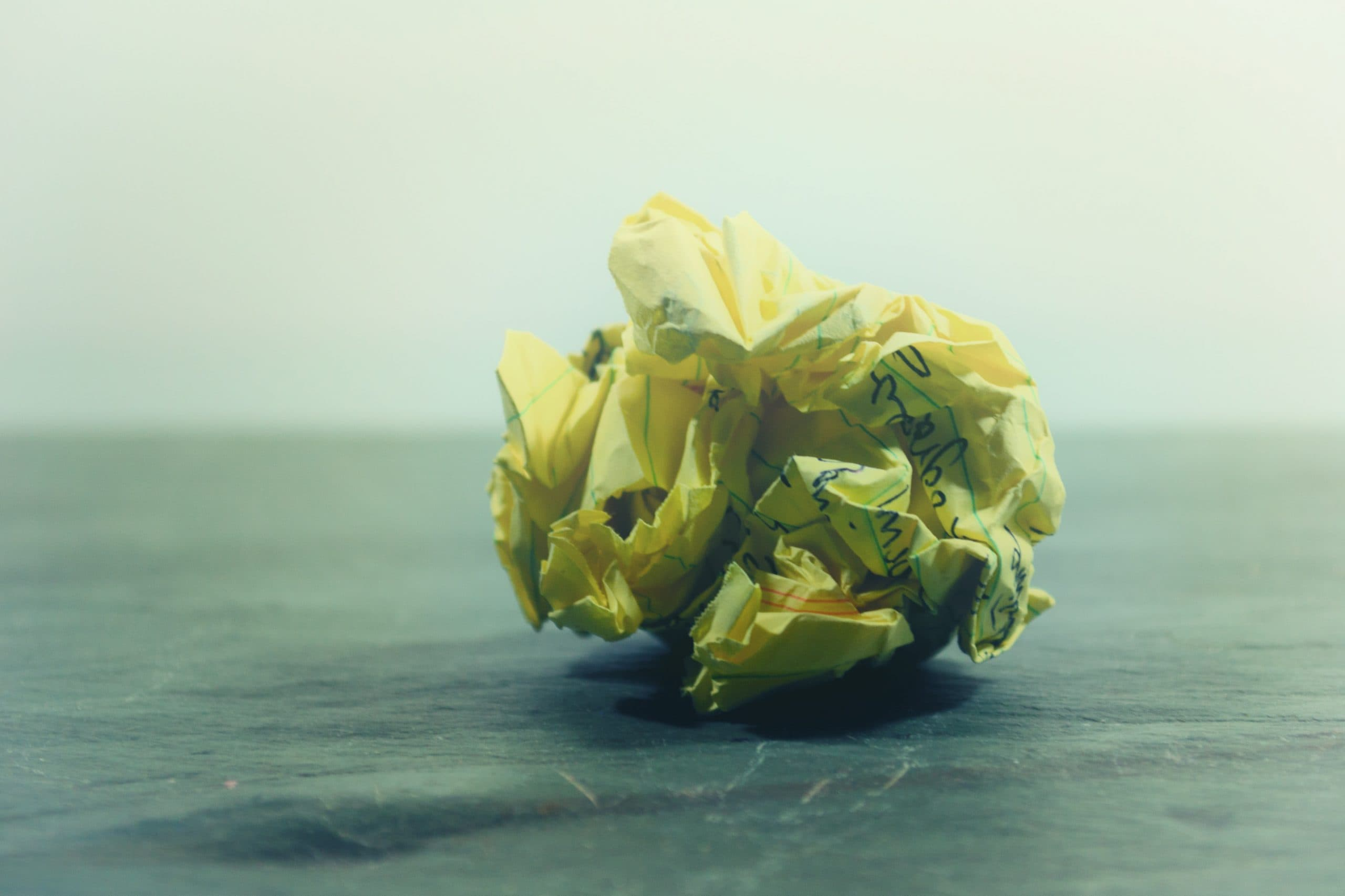 A piece of scrunched up yellow paper