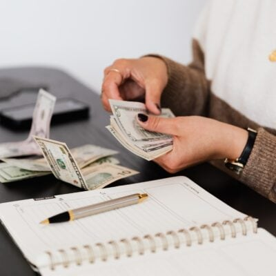 Woman's hands counting out bank notes