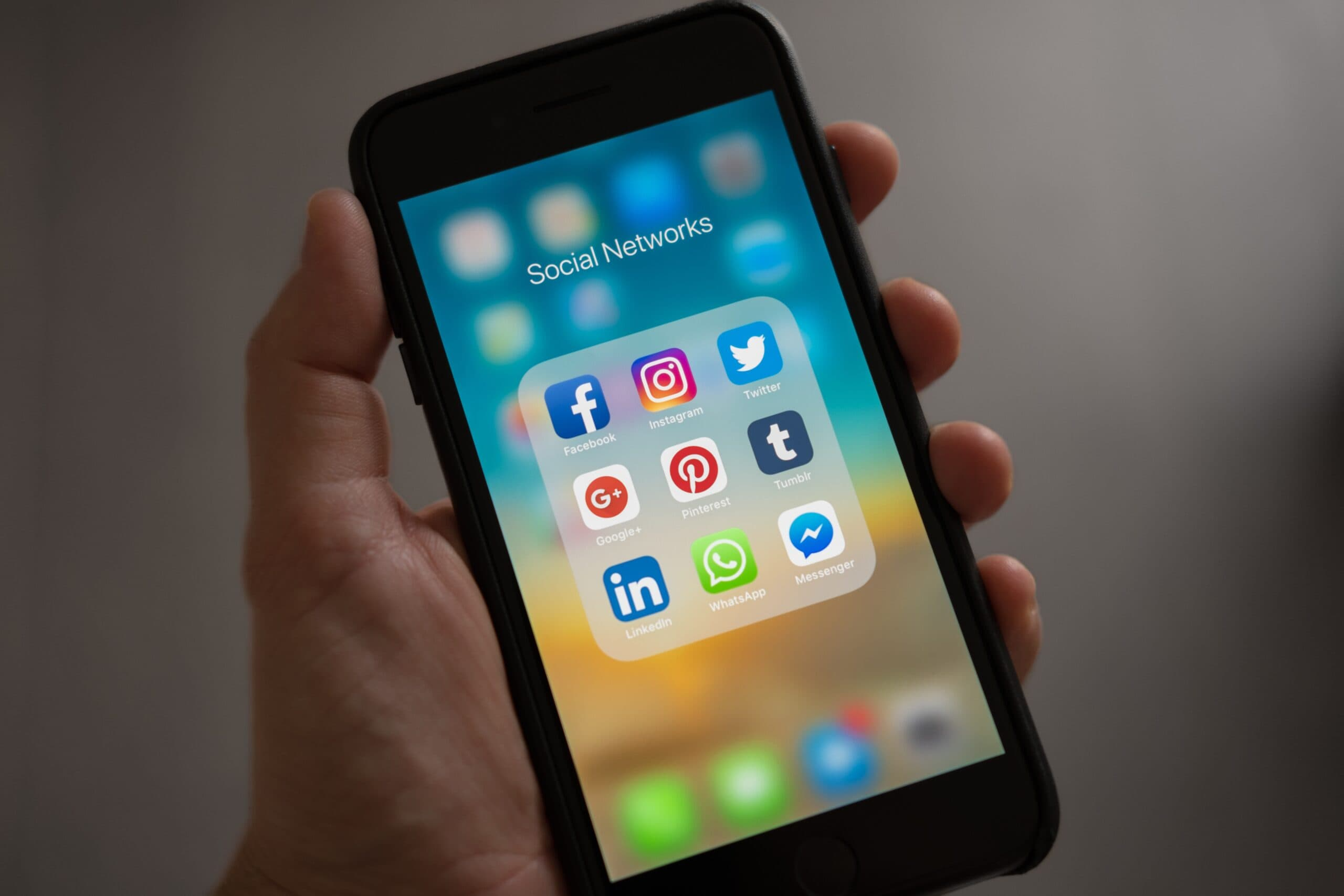Smartphone showing social media app icons